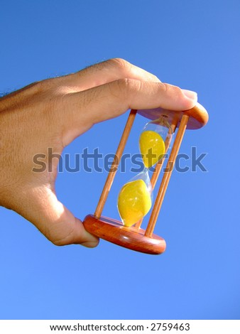 Holding a sand-glass - stock photo