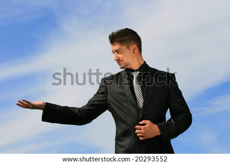 Holding an object in the palms of his hands. - stock photo