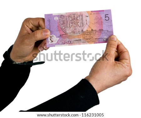 Holding and showing Australian 5 Dollar note - stock photo