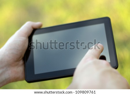 holding and touching on tablet pc. Close-up image - stock photo