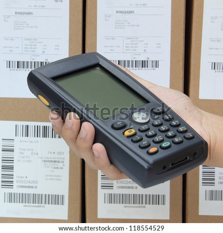 Holding Barcode scanner operated on PocketPC - stock photo