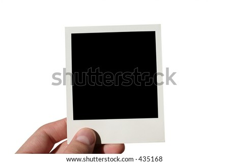 holding blank instant film sheet - isolated - stock photo