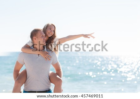 holding, blue, person, together, scenic, romantic, beautiful, water, nature, happy. happy couple in sunglasses on beach. Beach couple laughing on travel honeymoon vacation summer holidays romance.