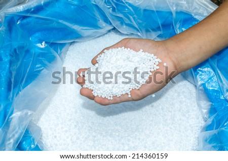 Holding chemical fertilizer - stock photo