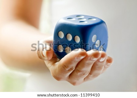 Holding Dice - stock photo