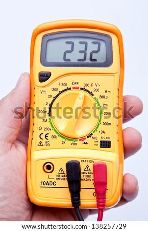 holding digital multimeter - stock photo