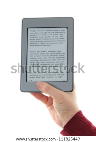 Holding E-book reader in hands,   The reader is deprived of all brand names and buttons, includes a sample text: Lorem Ipsum, which is the text used as an example of a filler in the printing industry. - stock photo