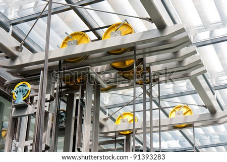 Holding frame of an open steel lift shaft in a modern building - stock photo