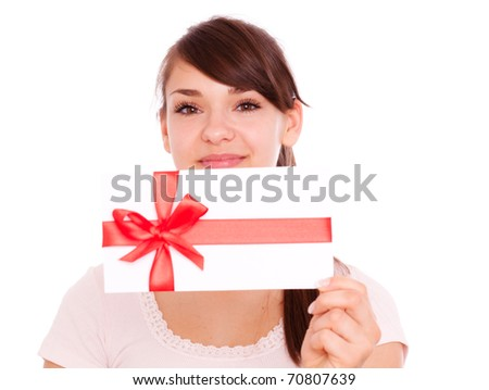 Holding gift card bonus female smiling - stock photo