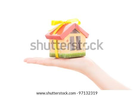 holding hand house - stock photo