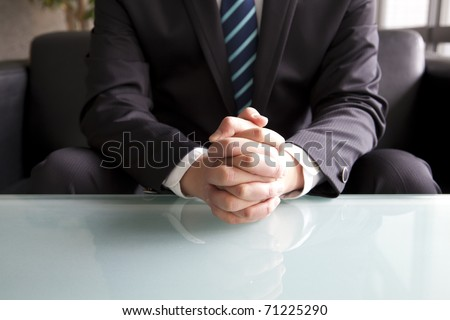 Holding hand of businessman - stock photo