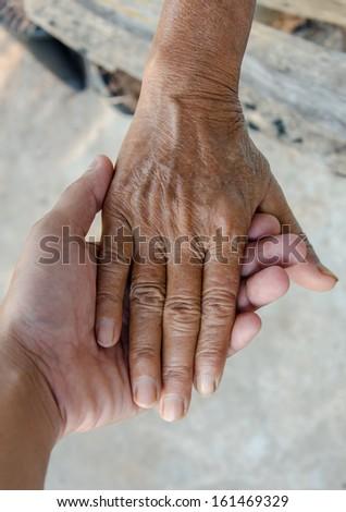 holding hand Senior old women. - stock photo