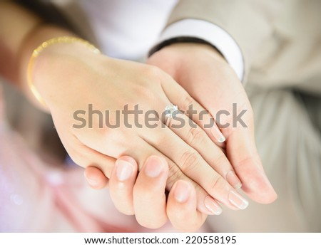 Holding hand with diamond ring - stock photo
