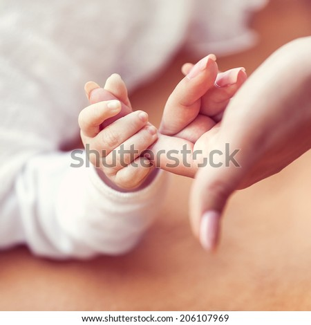 Holding Hands - stock photo