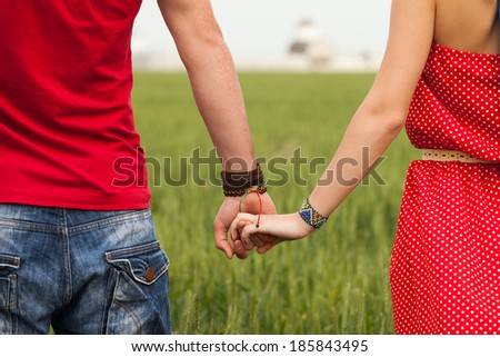 Holding hands couple