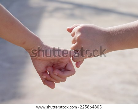 Holding hands together. , Be hand in hand. , Friendship and Binding.