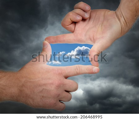 holding hands up and seeing a vision of a bright future - stock photo