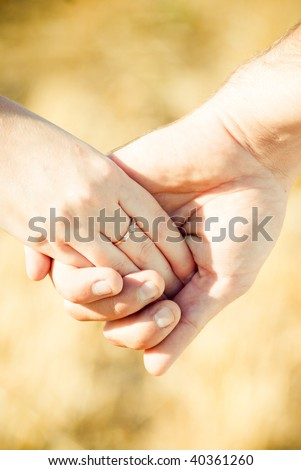 Holding Hands With Wedding Ring, Close-up - stock photo