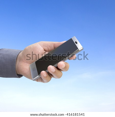 holding mobile phone out door