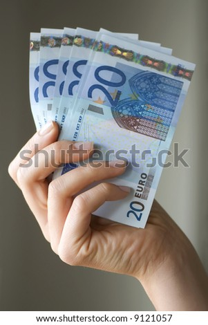 Holding Money - stock photo