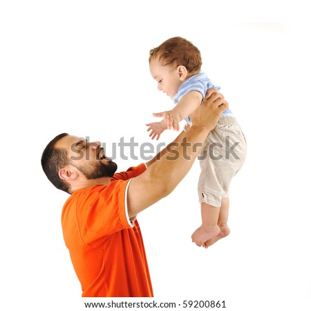 Holding my son, studio shutting, father and baby son together - stock photo