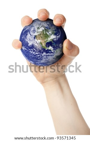 Holding planet Earth in fist. Earth globe image provided by NASA. - stock photo