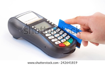 holding plastic card in payment machine - stock photo