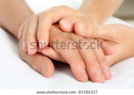 Holding senior hand - stock photo