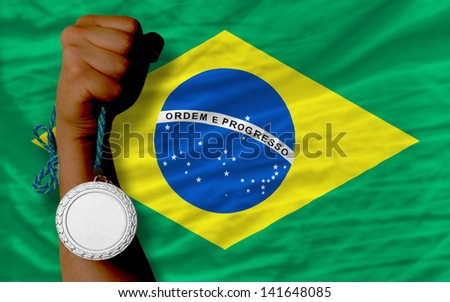 Holding silver medal for sport and national flag of brazil