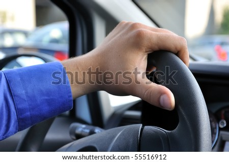 holding steering wheel - stock photo