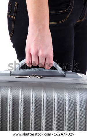 Holding suitcase in hand isolated on white - stock photo