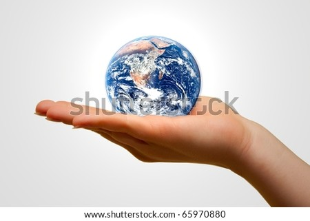 Holding the Earth - stock photo