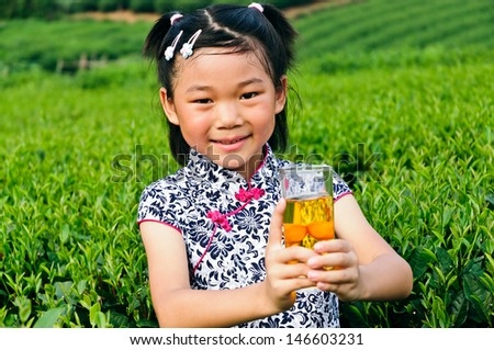 Holding the green tea of Asian little girls