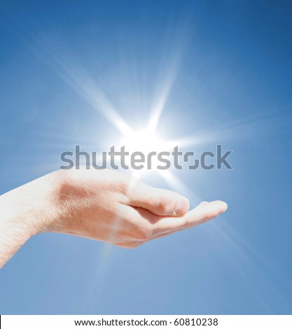 Holding the sun - stock photo