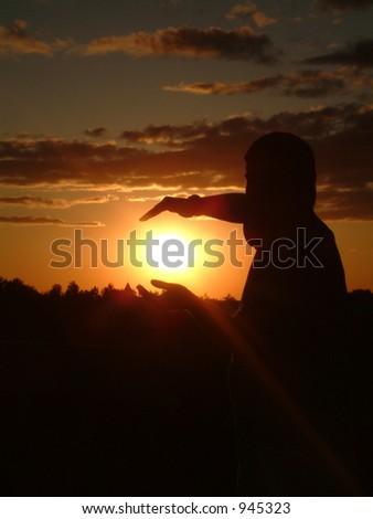 Holding the Sun - stock photo