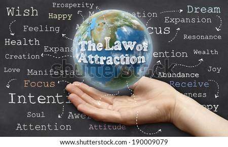Holding the World with The Law of Attraction - stock photo