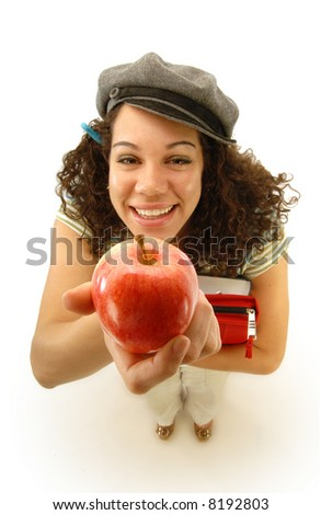 Holding up a classic bribe for an unsuspecting teacher; focus on the apple - stock photo