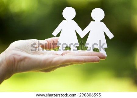 holding white paper venus symbols, lesbian concept - stock photo