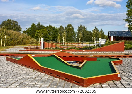 Hole at a miniature golf course - stock photo