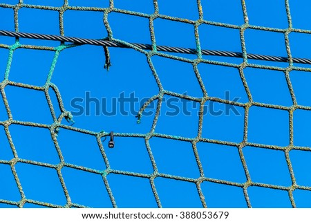 hole in a net - stock photo