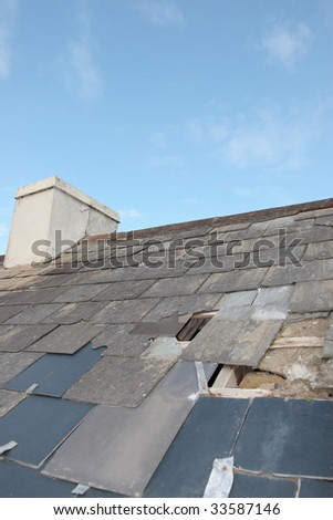 hole in a roof due to storm or decay - stock photo