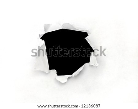 Hole in a sheet of paper - stock photo