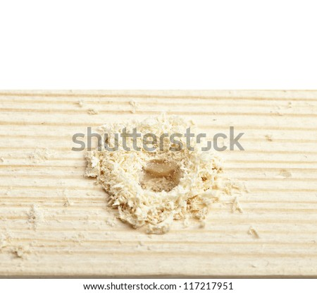 hole in a wooden board. Isolated on white.