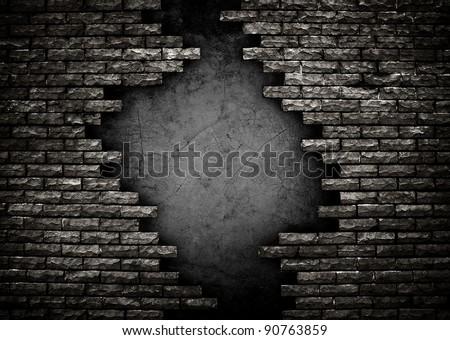 hole in brick wall - stock photo