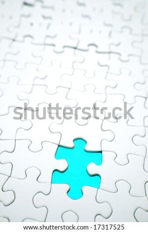 Hole in jigsaw puzzle - stock photo