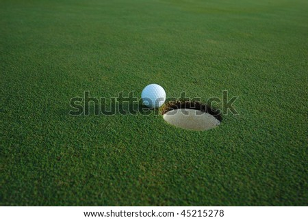 Hole in One - ALMOST!  The joys and frustration of golf... - stock photo