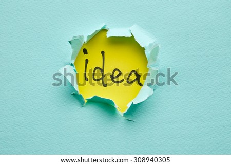 Hole in the blue paper. Idea - stock photo