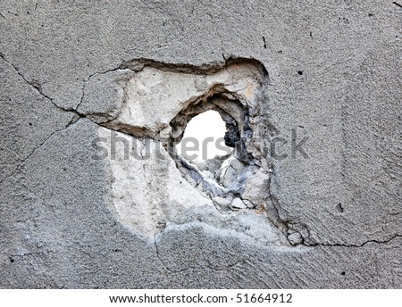 hole in the concrete, the conceptual background - stock photo