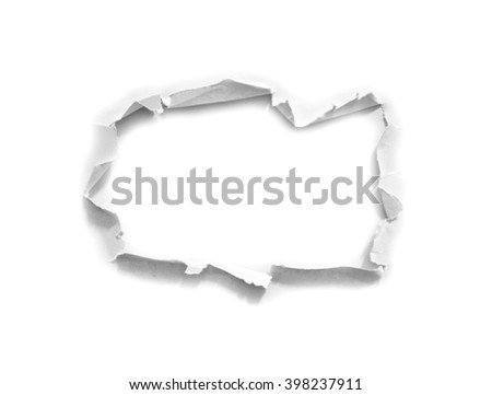 Hole in the paper on white - stock photo
