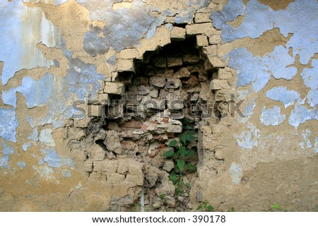 hole in the wall - stock photo